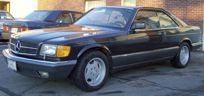 A beautiful 1991 Mercedes-Benz 560SEC in DB199 Black Pearl Metallic in for routine service, misc. interior trim replacement, and a new antenna mast.